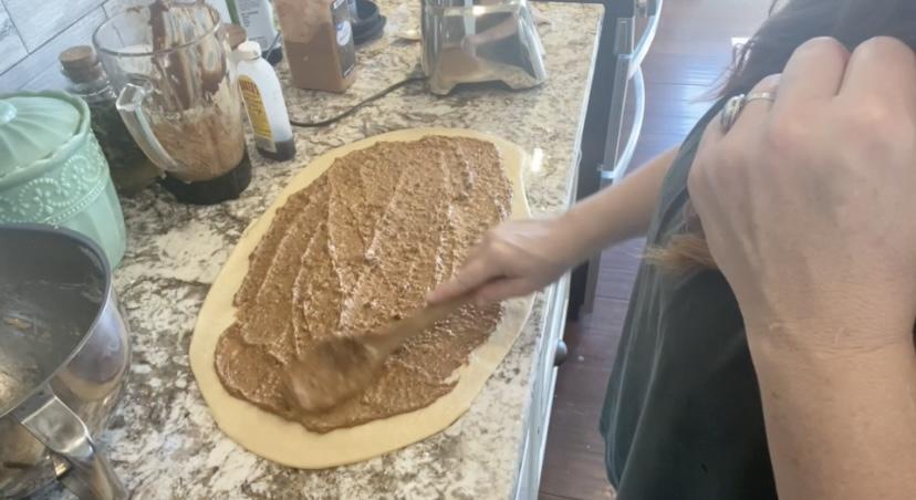 spreading date cinnamon roll filling