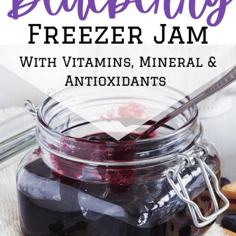 blueberry jam in jar with open lid and text