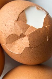 cracked boiled egg for loaded potato salad