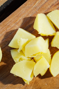potatoes chopped on cutting board