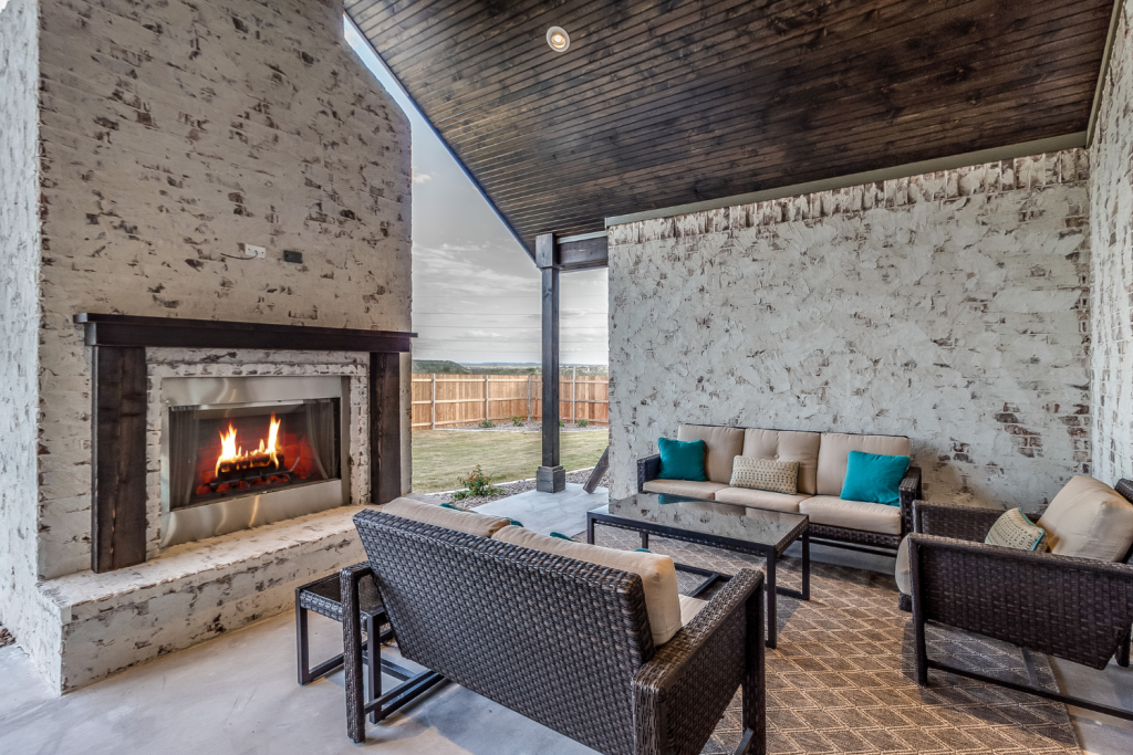 outdoor porch with gas fireplace and seating