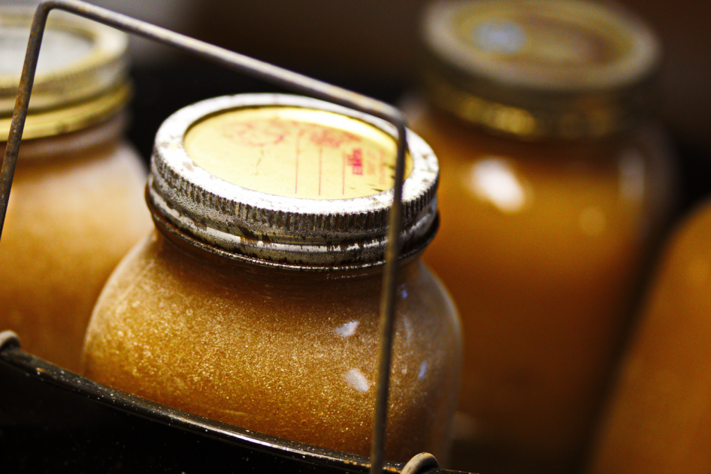 applesauce jars coming out of canner