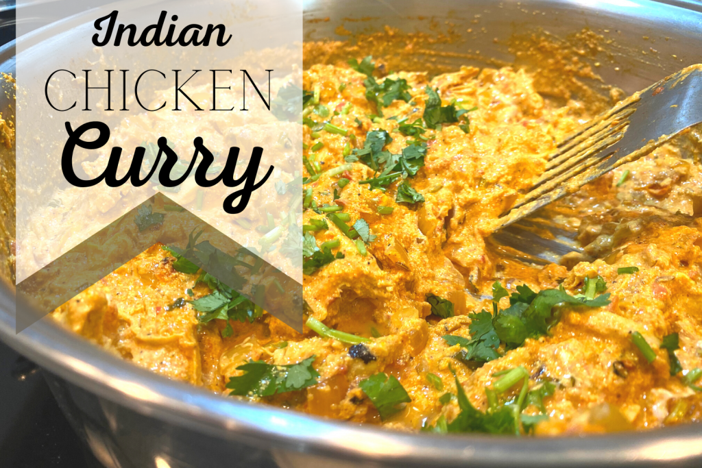 indian chicken curry in pan with text