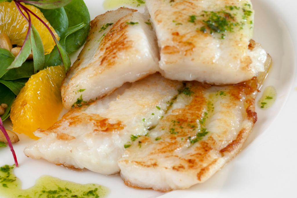 fried sea bass with salad